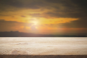 Perspective wood floor brown color texture with blur beautiful nature background.