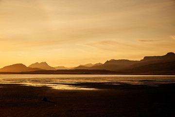 Sunset in Iceland. The silhouettes of the mountains.