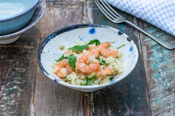 Prawn, fennel and rocket risotto on a table in the gargen. Outdoor dining.