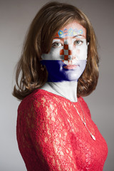 Portrait of woman with painted Croatia Flag
