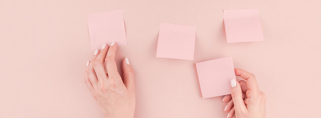 Woman hands with paper stickers
