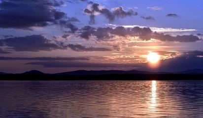 dark blue and orange evening sky over the lake