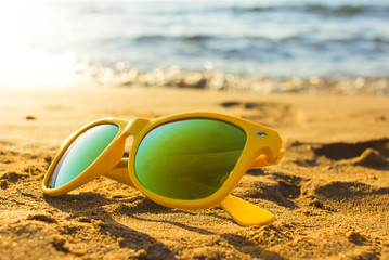 Sunglasses on the tropical beach. Travel relax vacation - azure sea, white sand, shining sun, Summer paradise day on exotic bay