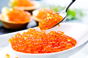 Caviar. Salmon caviar in a bowl. Closeup trout caviar. Gourmet food. Seafood.