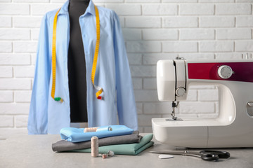 Sewing machine, fabrics and accessories for tailoring on table