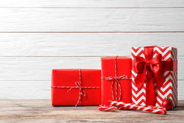 Beautiful composition with Christmas gift boxes on wooden table