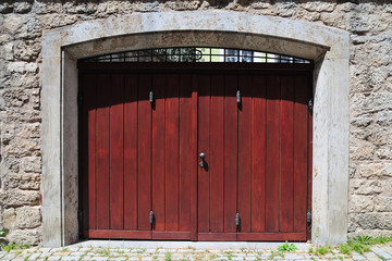 wooden gate in stone wall