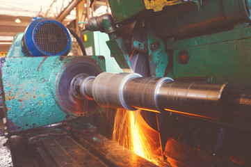 Machining of the internal hole on a coordinate grinding machine with sparks, in an industrial plant.