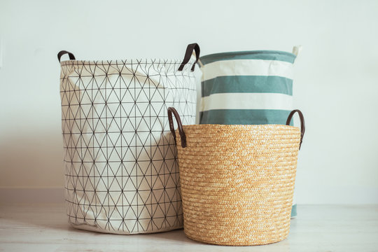 interior of white stylish room with laundry basket