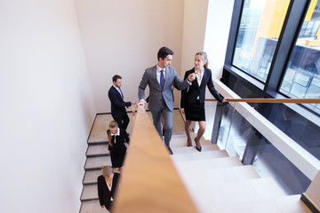 Group of business people walking at stairs