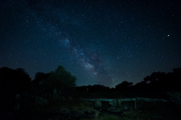 Milky way over an old bridge. Puente de Simon Ruano. Montehermoso. Extremadura. Spain.