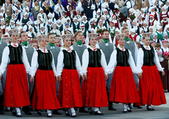 Choir singers and dancers perform during the final show at the Song and Dance Celebration in Riga