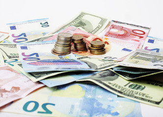 Cash on table isolated: dollars, euro, rubl broken money. All in