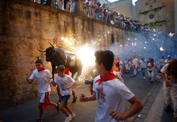 Revellers run from the Fire Bull at the San Fermin festival in Pamplona