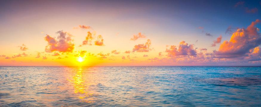 Beautiful sunset over ocean island maldives long panorama