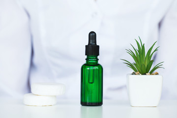 Herb Medicine. Production and Packaging of Cosmetic Products. Moisturizing Face Cosmetic. Beauty Product Concept, Doctor and Medicine Experiments