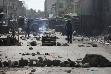A man walks along a blocked street in Port-au-Prince