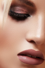 Closeup with of beautiful blond woman. Fashion makeup, clean shiny skin. Makeup and cosmetic. Beauty style on model face