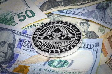 Freemason symbol coin on hundred dollar bills. Cryptocurrency background