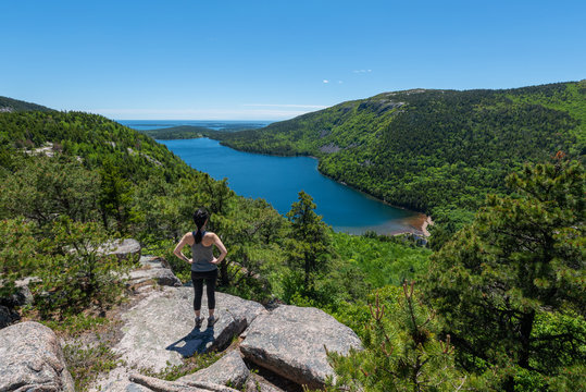 Female Hiker looking at Jordan Pond in Acadia National Park
