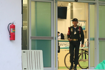 A security officer walks at the Chiang Rai Prachanukroh hospital in the northern province of Chiang Rai