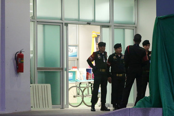 Security guards gather at the Chiang Rai Prachanukroh hospital in the northern province of Chiang Rai