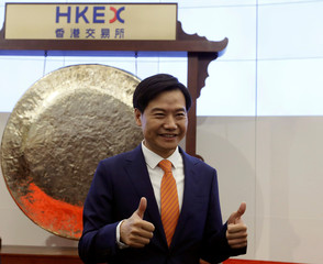 Xiaomi founder Lei Jun attends listing of the company at Hong Kong Exchanges in Hong Kong