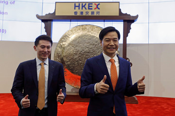 Xiaomi founder Lei Jun and CEO Shou Zi Chew attends listing of the company at Hong Kong Exchanges in Hong Kong