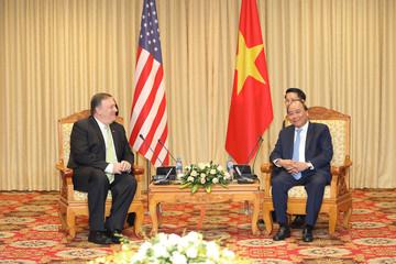 U.S. Secretary of State Pompeo smiles beside Vietnamese PM Nguyen Xuan Phuc in Hanoi