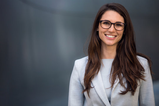 Smart, intelligent, friendly, likable portrait of an executive business woman manager, advisor, agent, representative with glasses