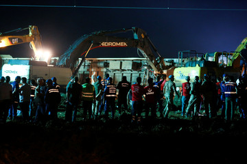 Rescue workers and paramedics work at the site of a train derailment near Corlu in Tekirdag province, Turkey