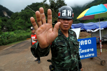 A soldier block a road leading to Tham Luang cave complex in the northern province of Chian  Rai