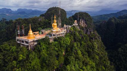 Fotobehang Bedehuis Buddha on the top Mountain of Wat Tham Seua (Tiger Cae) , Krabi,Thailand