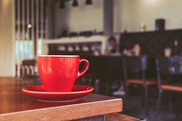 red coffee cup in cafe, on morning
