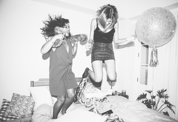 Girls jumping on the bed together