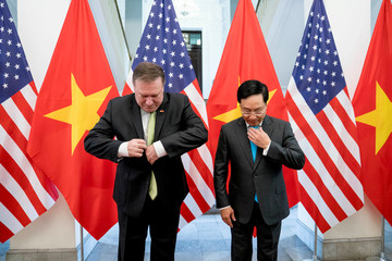 U.S. Secretary of State Pompeo and Vietnamese Deputy PM and FM Pham Binh Minh arrive for a photo opportunity before a meeting in Hanoi