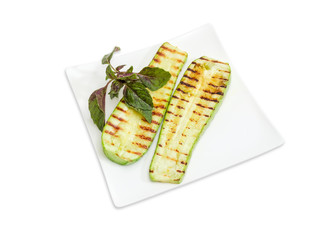 Grilled sliced vegetable marrows on the square white dish