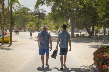 Two guys walking in Haiti