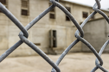 Wire fence surrounding the exercise yard for death row inmates at the Idaho State Penitentiary, Boise, Idaho, USA.