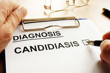 Doctor is holding form with Candidiasis.