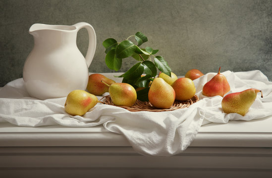still life with fresh pears on wooden table