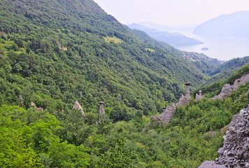 Zone Pyramids, unique form of geological erosion created an uncanny landscape of boulders perched atop slender columns of clay, near Iseo Lake, Lombardy, Italy