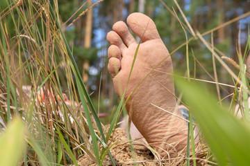 Feet resting on the beach men