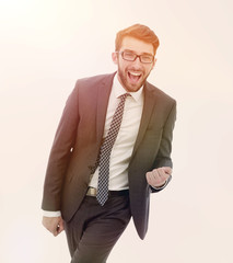 happy businessman confidently goes forward.
