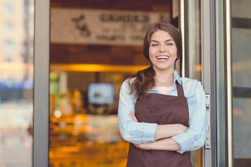 Foto op Plexiglas Bakkerij Smiling woman in the bakery