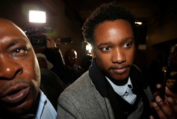 Duduzane Zuma, the son of scandal-plagued former South African president Jacob Zuma, arrives in court ahead of being charged with corruption, in Johannesburg
