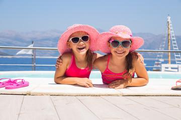 little girls on sea coast