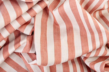 Gray and brown stripes. Striped brown and grey textile pattern as a background. Close up on...