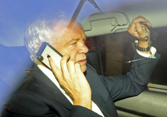 Britain's former Secretary of State for Exiting the European Union David Davis leaves the BBC by taxi in central London
