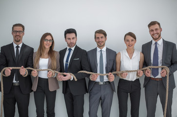 business team tied with sturdy rope